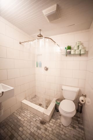 The Brazil Room has an ensuite bathroom with a waterfall shower and beautiful stone tile.