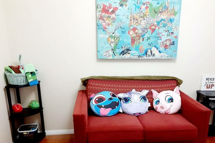 Twin pull out sofa bed in a whimsical room full of toys