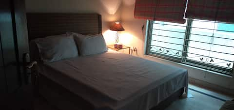 A nicely decorated ac room at a central location