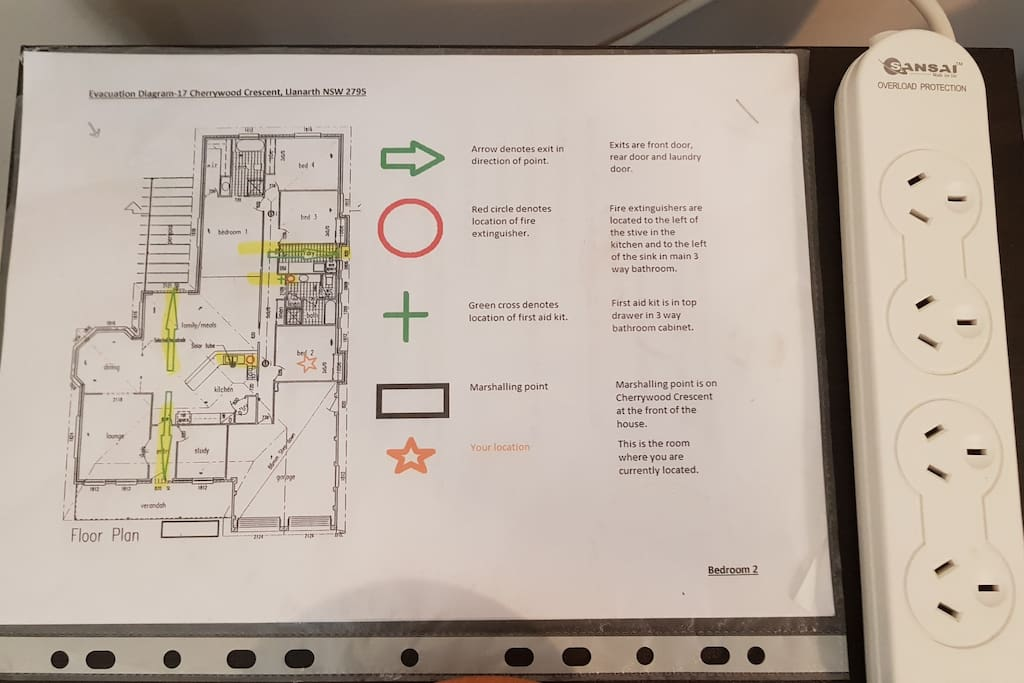 Evacuation plan showing first aid kit, fire extinguishers and exits. Charging stations in all rooms.