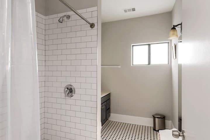 Tile shower in shared bathroom
