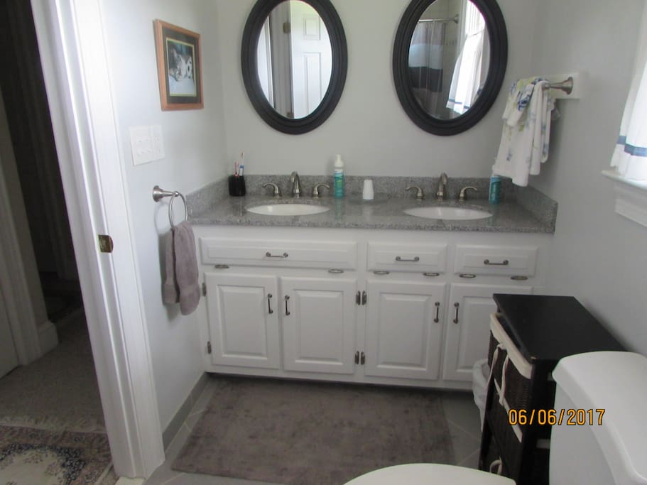 Bathroom with double sink and shower.  This bathroom is in the hall and maybe shared.