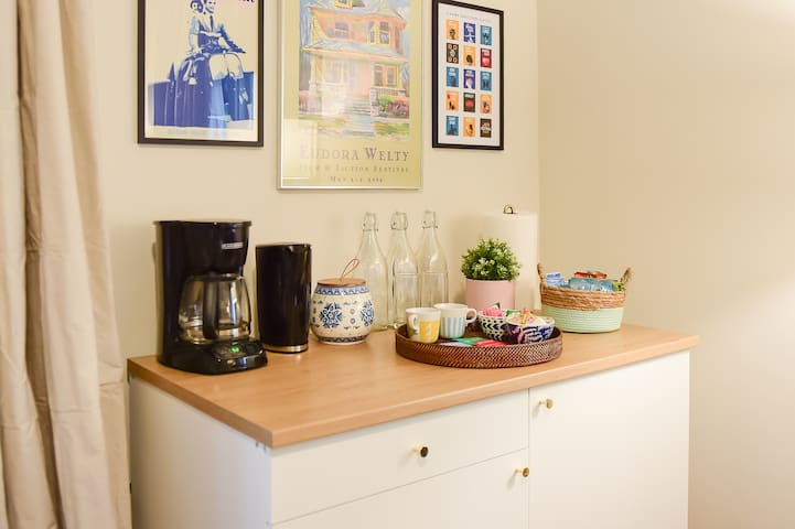 kitchenette includes dishes, utensils, glasses, coffee cups, and more