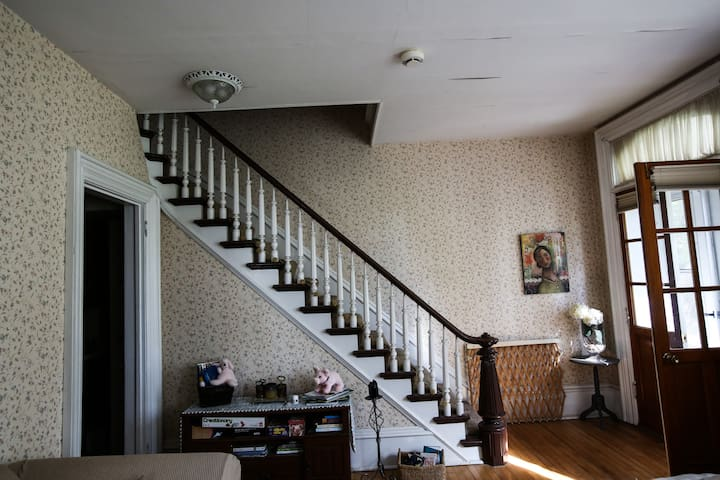 Living room staircase leading upstairs to your suite.