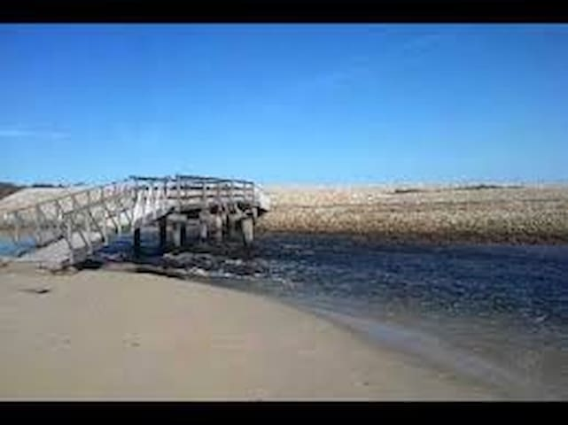 Foot bridge at the end of the beach connecting to another beach