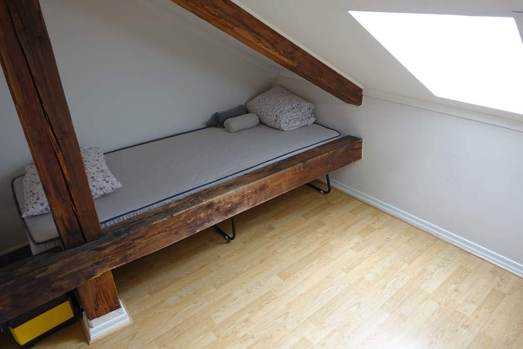 The loft space and single bed for rent.