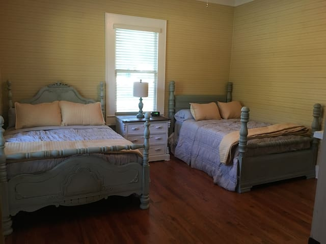 Guest bedroom with full size beds and memory foam mattresses