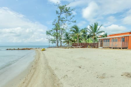 Secluded seaside cabana with beach access, a porch & hammock!