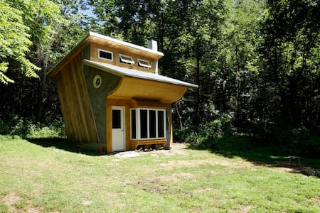 Unique, off-the-grid slanted cabin on 20 acres