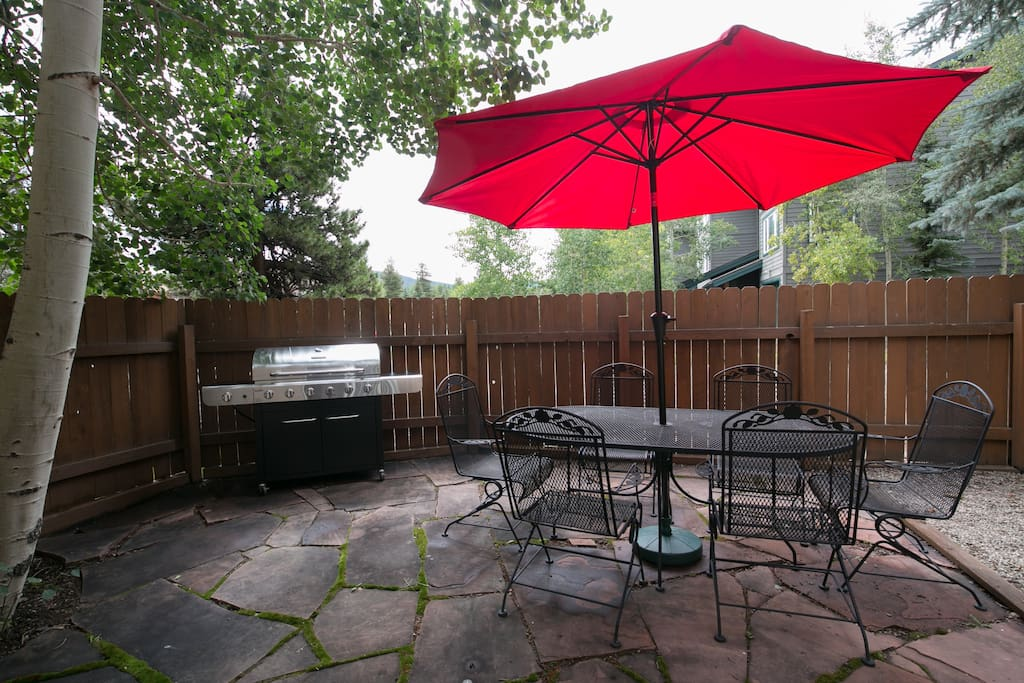 With 7 burners, the stainless grill on the shaded patio can handle group meals.