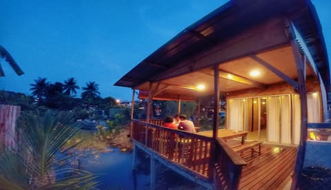 Tung's Tropika - with a wooden hut by a lake
