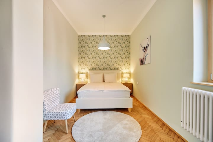 Geometric wallpaper adds an individual touch to the second bedroom.