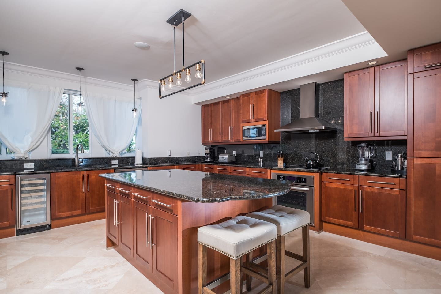 Spacious Kitchen with Center Island & Adjoining Laundry Room