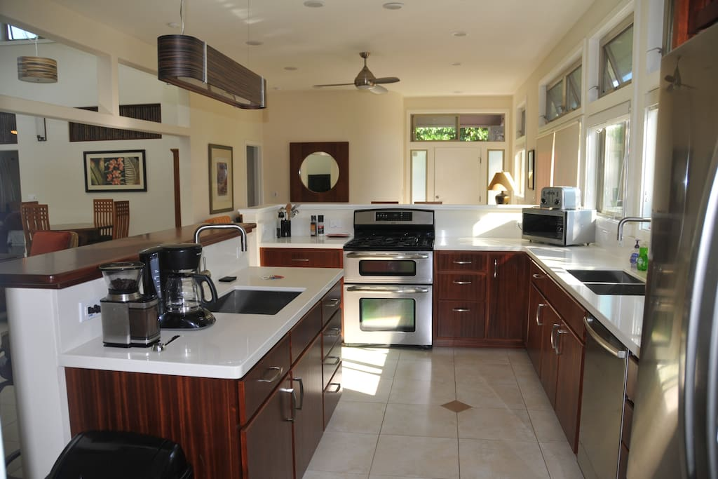 Kitchen in the Main house with propane stove and oven, large fridge with ice maker and water, two sinks and plenty of storage and counter space