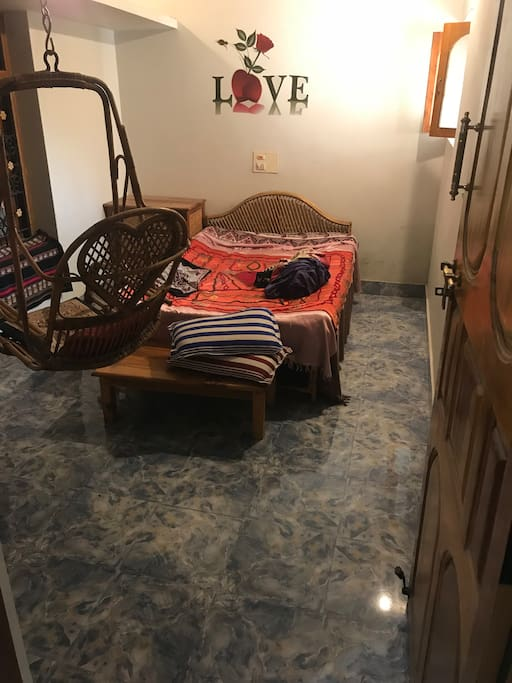 Bed room with a cane swing.
