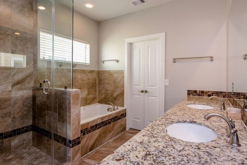 Steam Room Spa and Jacuzzi tub, the door pictured is the walk in closet