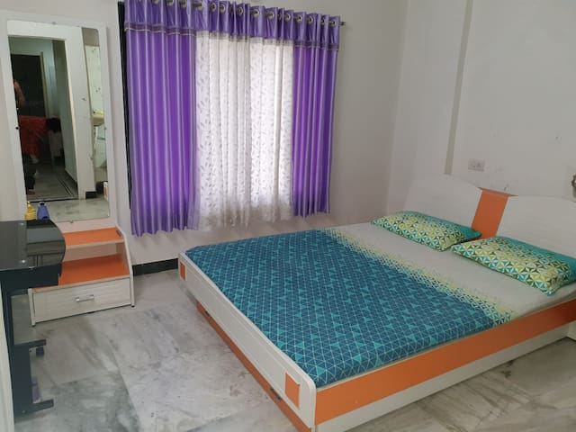 A comfortable bedroom in a 2 story bungalow.