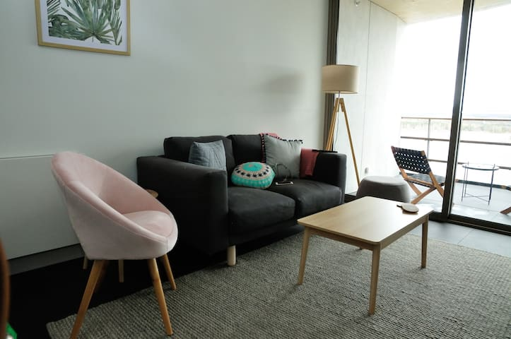 A cosy seating area to watch TV or enjoy the amazing view!