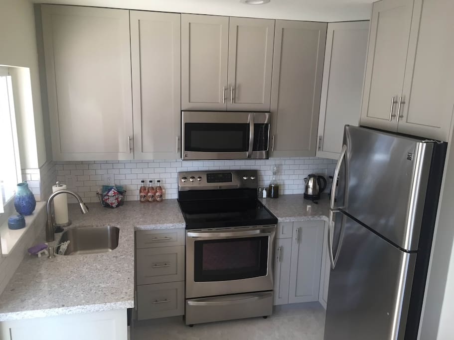 Quartz Countertops, Quality Cabinets, Natural Light. We have all the cooking supplies and coffee maker. Stop at the nearby Publix, Whole Foods or Trader Joe's for groceries and paper products.