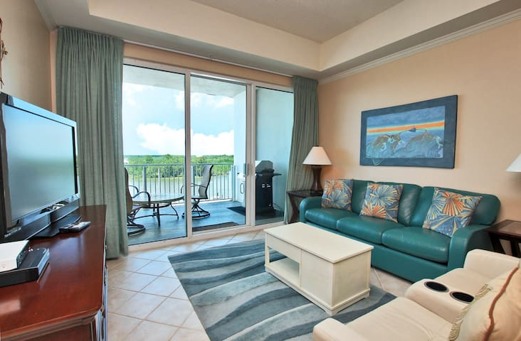 Wharf 504-Amazing Views from your very own 5th floor balcony! Enjoy all The Wharf has to offer including use of the  Oasis Water Park during your stay!