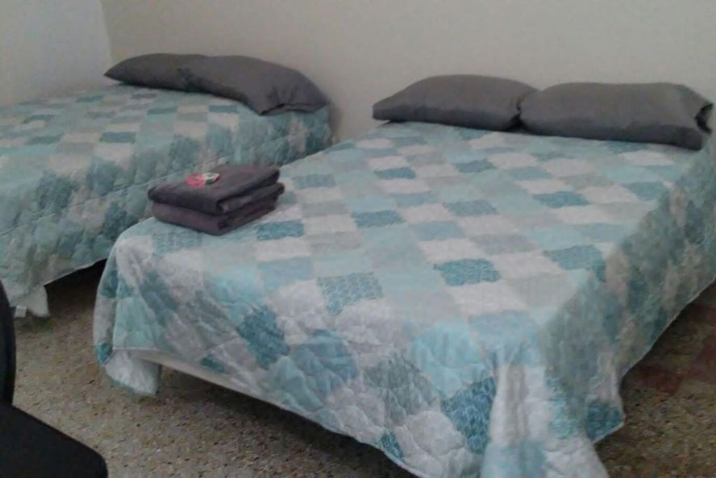 There are two full  beds and a dining table. The beds  include sheets and pillow. The kitchen is in front of the beds, with stove, refrigerator, a sink and a coffe maker.  The studio has a little private bathroom.