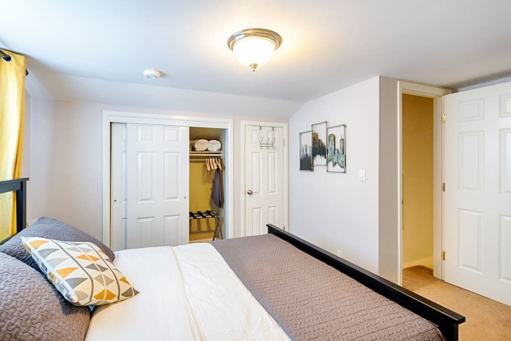 Deep closet will hold your luggage just fine. Bedroom door exits to stairs going down to main level.