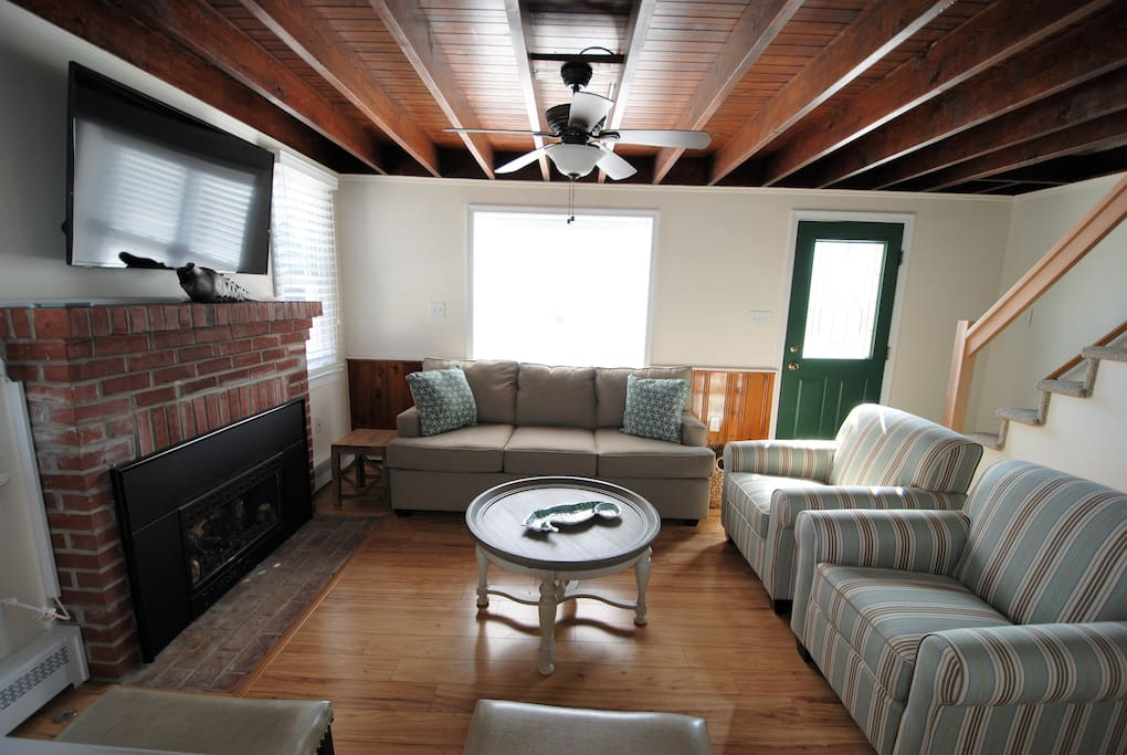 Wood beam ceiling warms the space of the living room, this view is from the kitchen to the living room