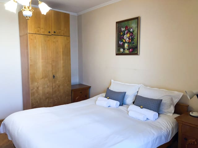 The main bedroom is homely, with all bedding and towels provided.