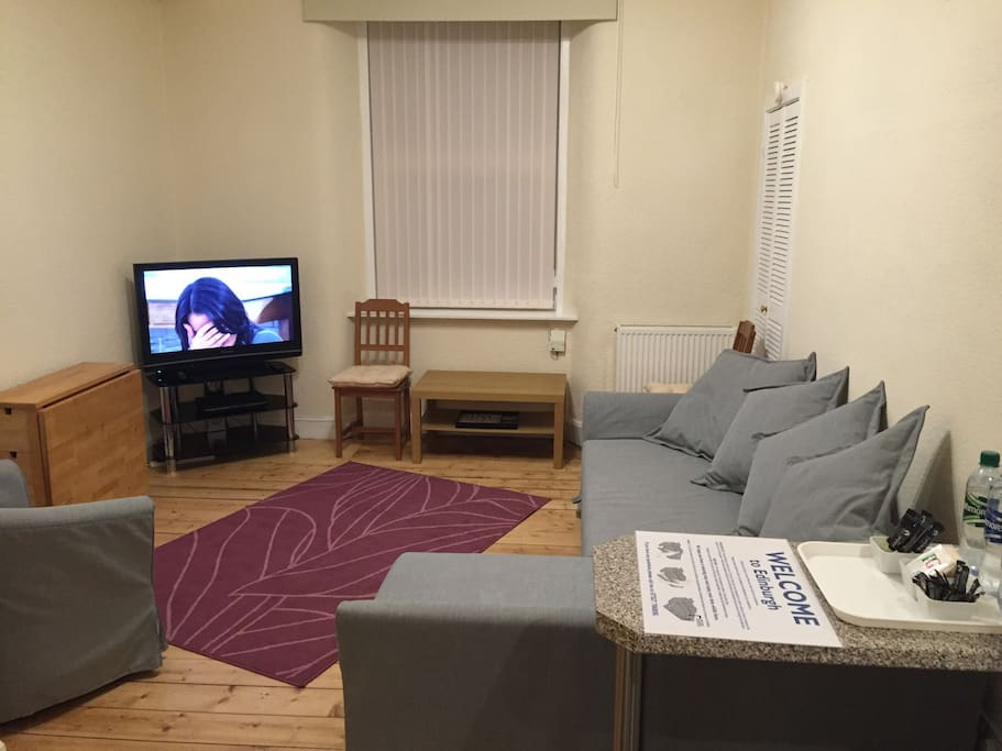 The Living Room has lots of comfortable seating and cable tv.
