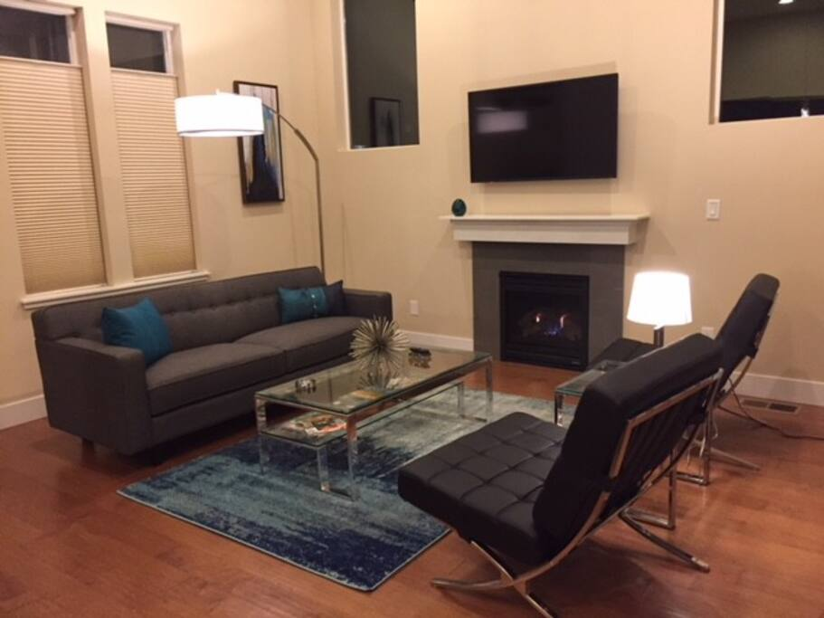 """Living Room with Gas Fireplace and 50"""" Roku TV"""