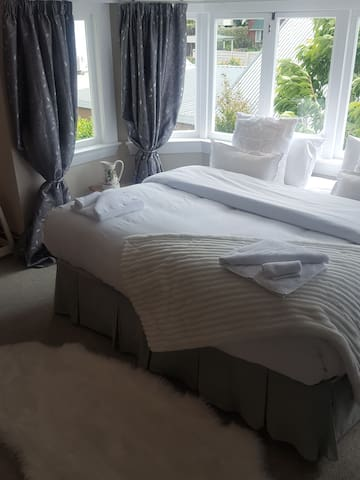 Attic room:  North, West and East facing. To the West there is a year-round magnificent garden view and sometimes mountain views on a very clear winter's day. To the East there is some sea view. All-round lovely sunny aspects.  Super King width bed.