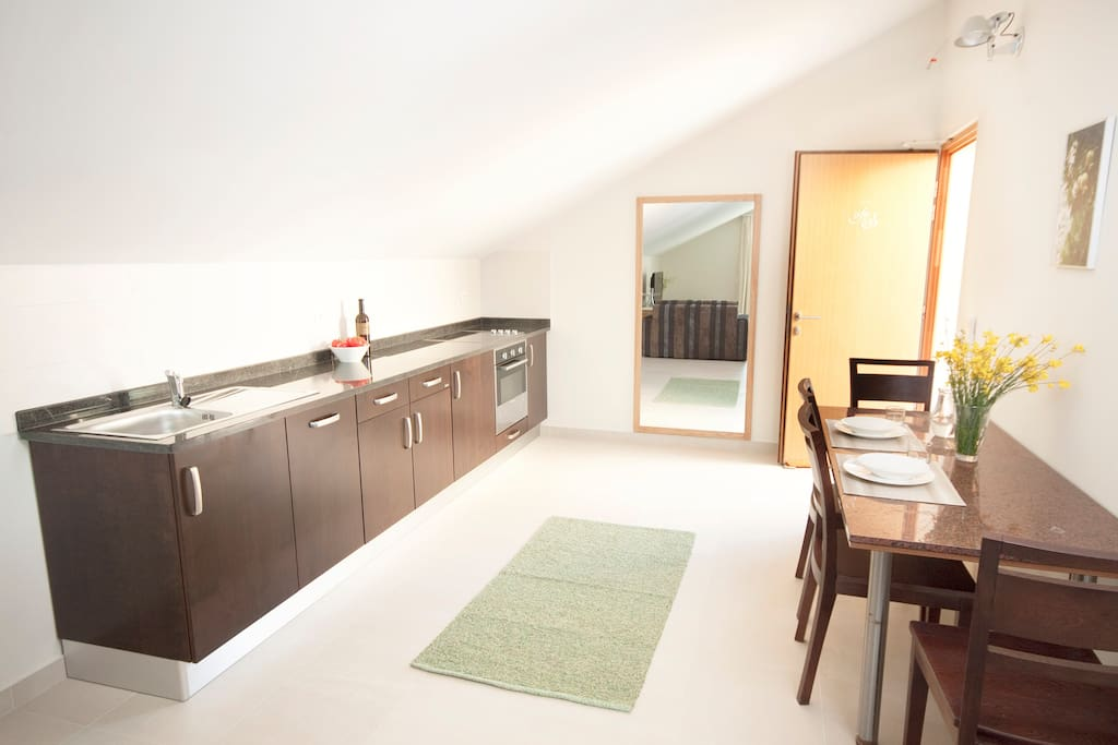 Spacious kitchen with  dining area.