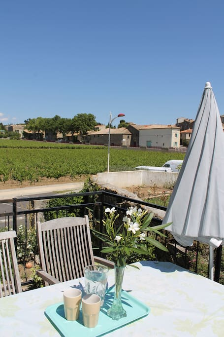 Sunny terrace with view of the vineyards and the old village.