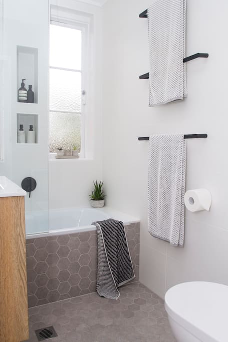The modern bathroom has both a bath and shower, and the apartment has an internal washer and dryer. Bath and beach towels will be provided.