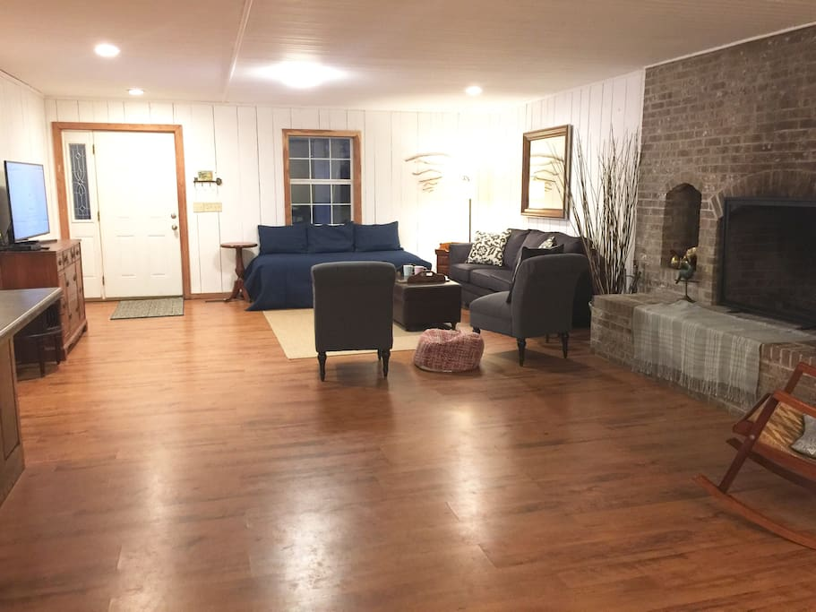 """Huge open living, dining, and Kitchen combo Room has 1 single ( extra long ) Can serve as sofa or extra bed. New 50"""" Flatscreen Smart TV with Cable and DVD player."""