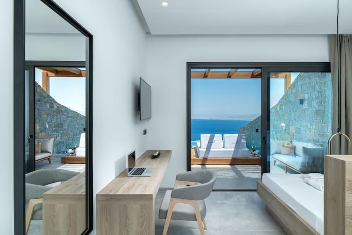Floor-to-ceiling glass doors offer beautiful sea views!