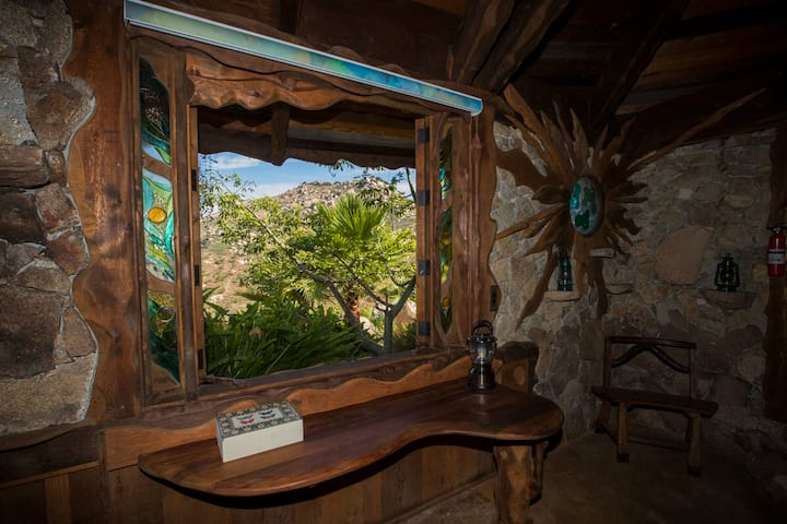 glass windows open up to let in natural light and outside breeze in real-life Hobbit House in California
