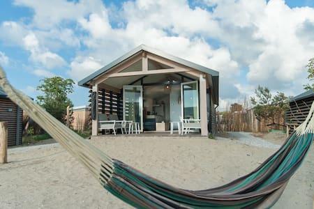 Beautiful lodge with hammock, near the beach