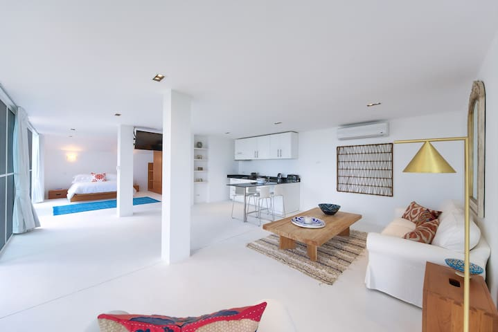 Light, airy contemporary open plan living space.