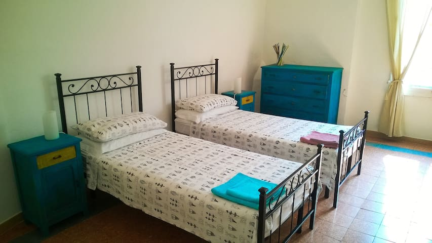 ROOM N° 1: two separate beds (can be used as double bed), wardrobe, dresser, mirror, writing table, 2 bedside tables and lamps.