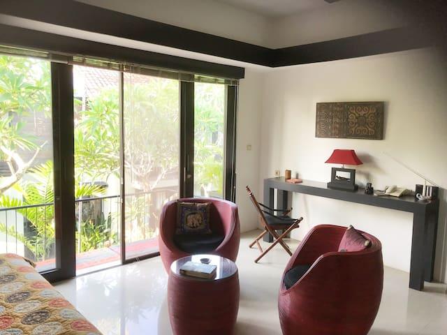 The spacious bedroom with door to balcony