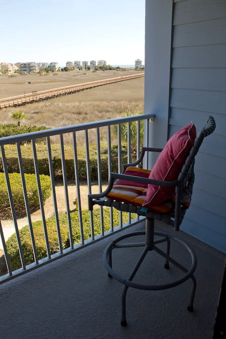 Balcony overlooking the natural wetlands, beach boardwalk and beach.
