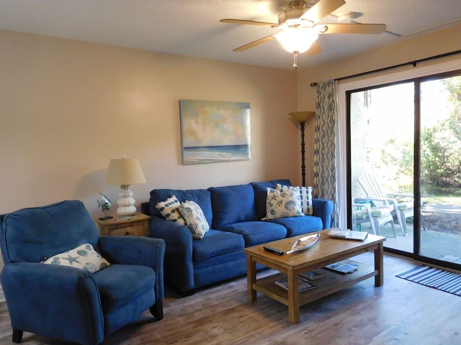 Open living area with queen sleeper sofa