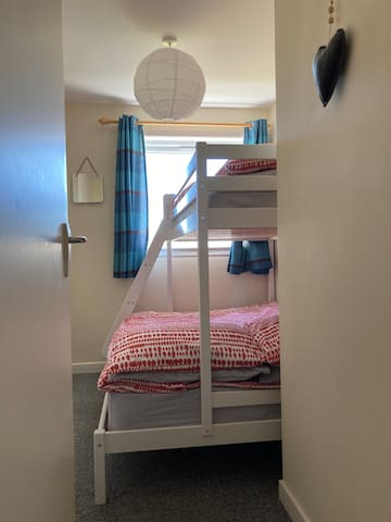 Second bedroom has a triple bunk. Small double below and single above. Perfect for couples or children.
