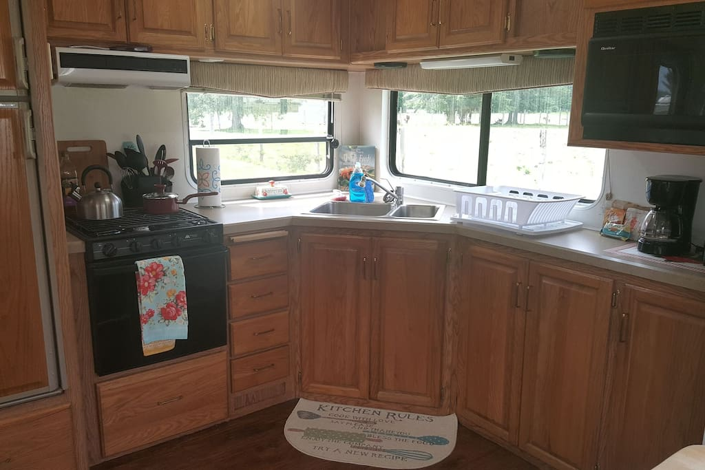 Spacious kitchen,  gas stove top and oven,  microwave, and fully equipped cookware for cozy dining in.