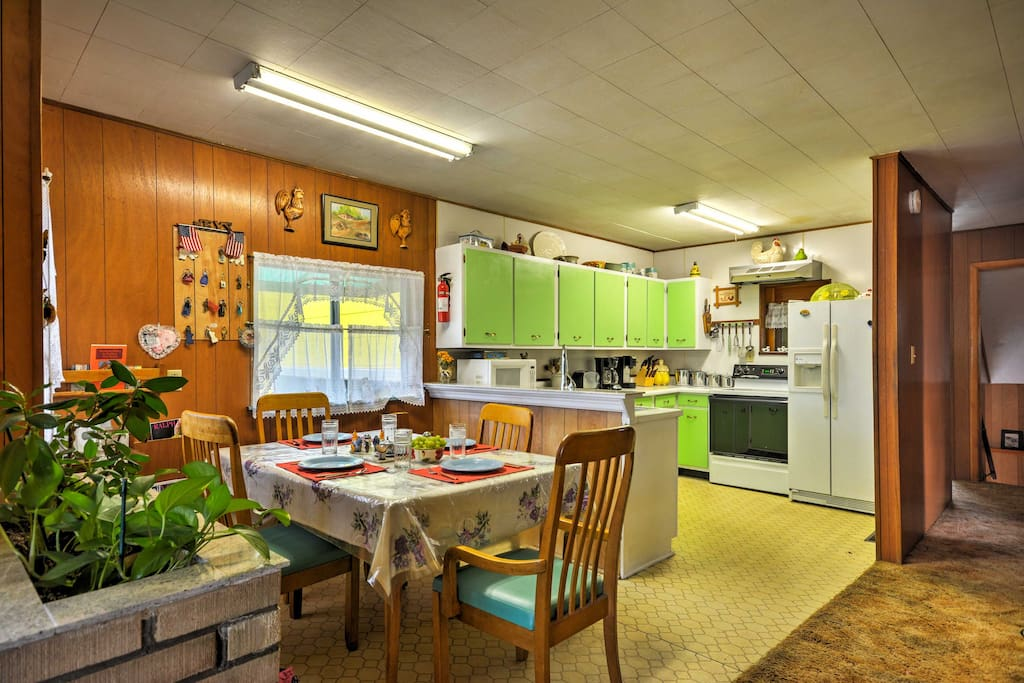 A fully equipped kitchen and dining table set for 4 makes it easy to dine at home during your stay at this home-away-from-home.