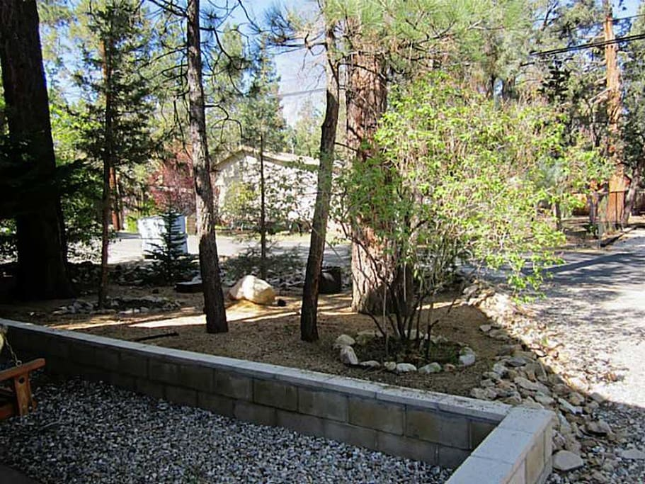 This view is looking from the front door of the cabin into the streets.  You'll have a wonderful landscaped front yard to greet you when you arrive.