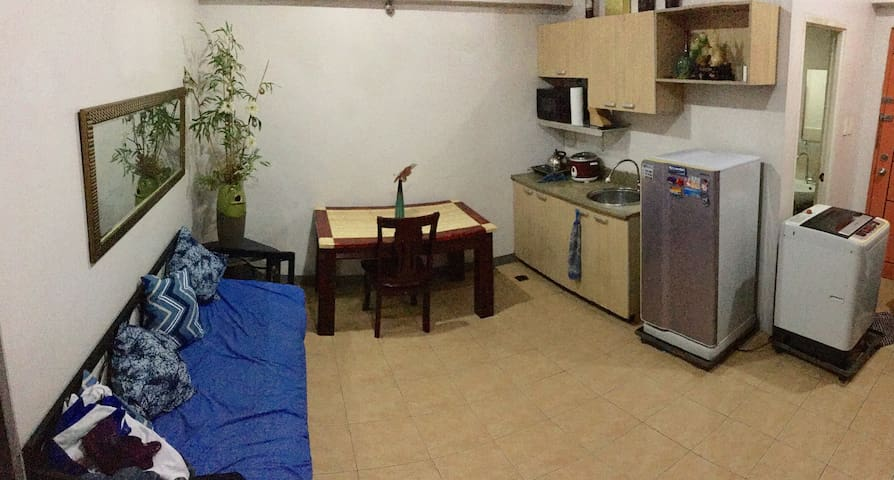 Spacious living and dining area of a 1BR condo unit in Cubao near Camp Crame, Santolan, Boni Serrano