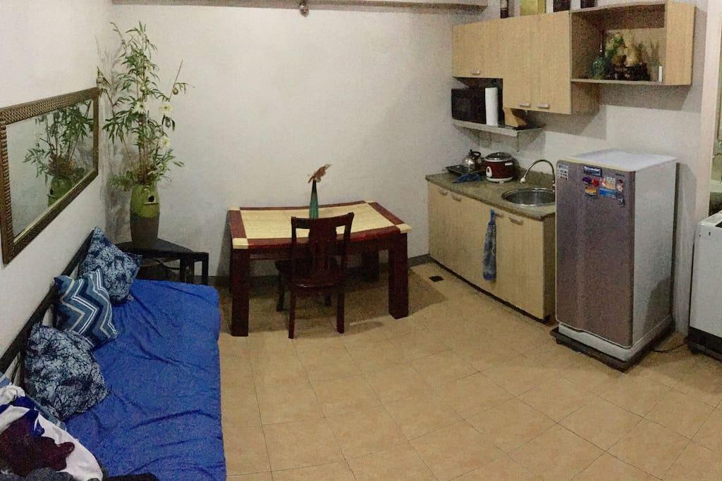 Spacious living and dining area of a 1BR condo unit in Cubao near Camp Crame, Santolan, Boni Serrano
