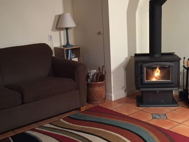 Curl up by the cozy wood burning stove